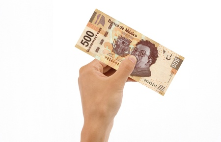 five dollars: Hand holding 500 Mexican Pesos Bill islolated on white background. Stock Photo