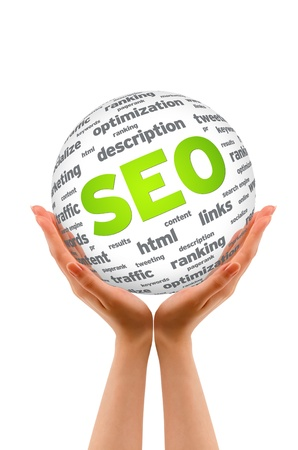 keywords link: Hands holding a SEO Sphere sign on white background.