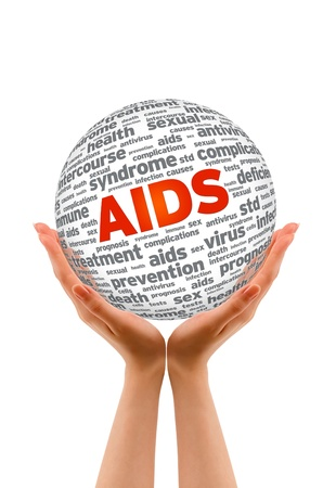 Hands holding a Aids 3D Sphere on white background. Stock Photo - 12413594