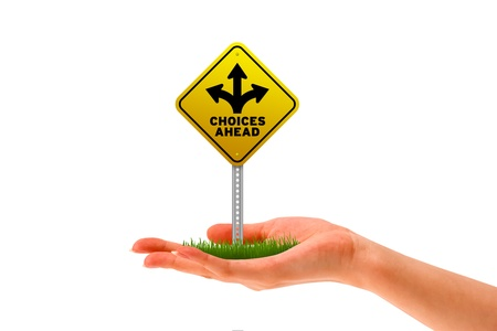 career choices: Hand holding a Choices Ahead street sign   Stock Photo