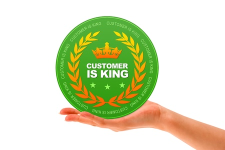Hand holding a Customer is King icon on white background. Stock Photo - 12721438