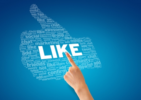 Hand pointing at a Like Thumb on blue background.  photo