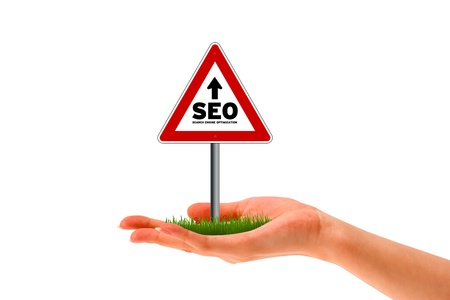Hand holding a search engine optimization street sign.  Stock Photo - 12721436