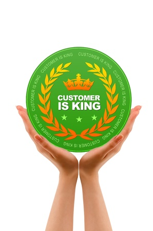 Hands holding a Customer is King Icon on white background. photo