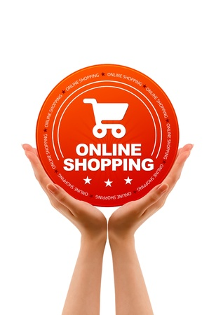 Hands holding a Online Shopping Icon on white background. Stock Photo - 12721444