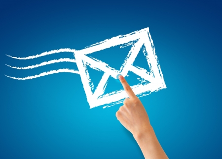 email contact: Hand pointing at a envelope on blue background.