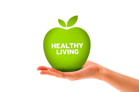 Hand holding a green healthy living apple.  Stock Photo