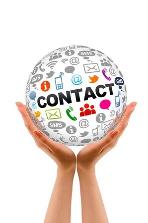 contact info: Mani in possesso di un giro Contattaci sfera. Archivio Fotografico
