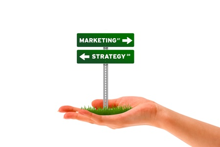 solutions freeway: Hand holding holding a marketing and strategy street sign.  Stock Photo
