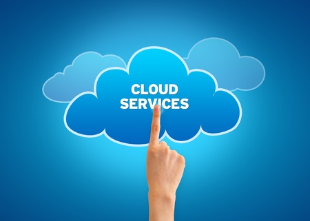 Hand pointing at a Cloud Services Cloud.