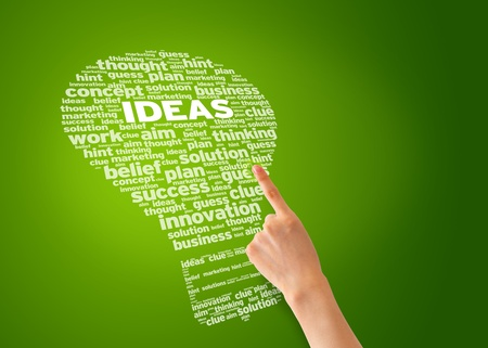 to innovate: Hand pointing a ideas word cloud illustration. Stock Photo