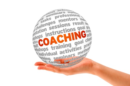 Hand holding a Coaching 3d Sphere on white background. photo