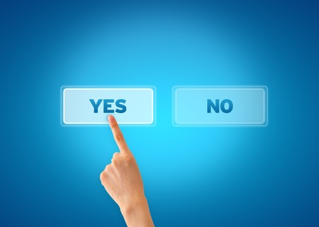 Hand pointing at an yes icon on blue background. Stock Photo - 13027812