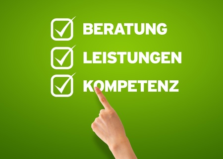 Hand pointing at a Customer Questionnaire on green background   photo