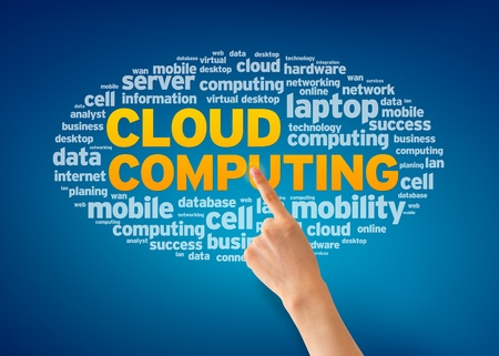 Hand pointing at a Cloud Computing Word Cloud on blue background  photo