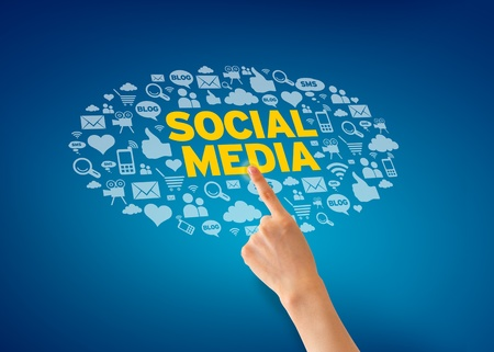 Hand pointing at a Social Media Icon cloud on blue background   Stock Photo