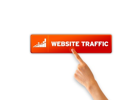 website traffic: Finger pointing a an orange Website Traffic icon.  Stock Photo