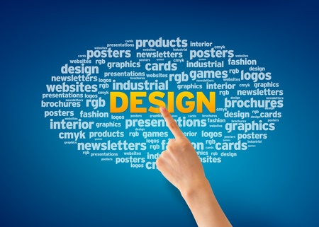 designer: Hand pointing at a Design Word Cloud on blue background. Stock Photo