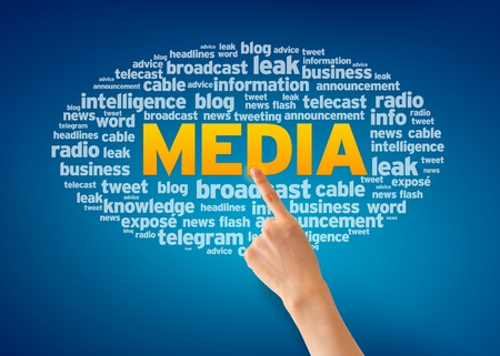 contribution: Hand pointing at a Media Word Cloud on blue background. Stock Photo