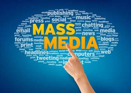 Finger pointing a an Mass Media Word Cloud on blue background.  photo