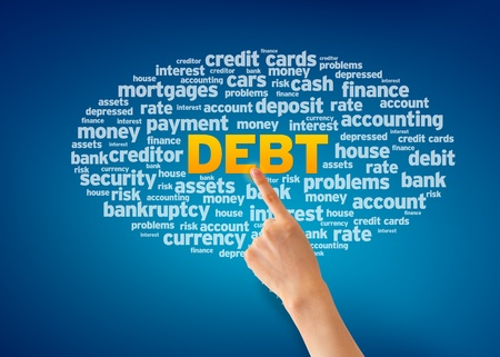 Hand pointing at a Debt Word Cloud on blue background. photo