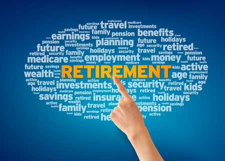 retirement money: Hand pointing at a Retirement word cloud on blue background. Stock Photo