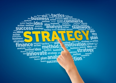 strategic planning: Hand pointing at a Strategy Word Cloud on blue background. Stock Photo