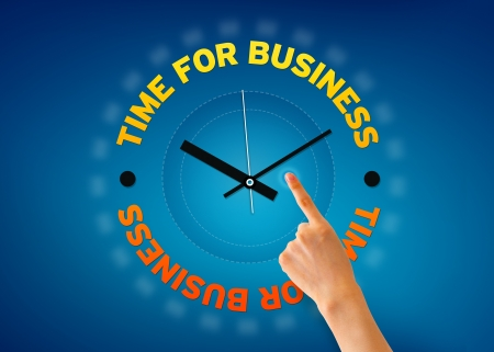 Hand pointing at a Time for Business clock on blue background. photo