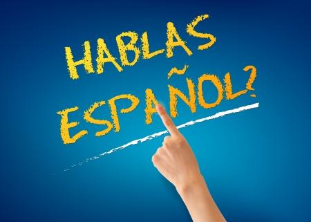 Finger pointing at a Hablas Espanol illustration on blue background.
