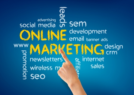 web marketing: Hand pointing at a Online Marketing illustration on blue background.
