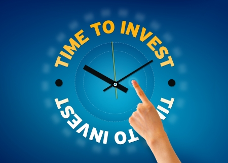 save time: Hand pointing at a Time to invest clock on blue background.