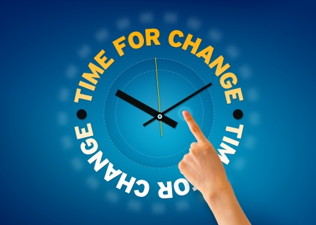 evolve: Hand pointing at a time for change clock illustration on blue background. Stock Photo
