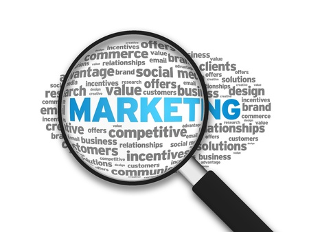 logo marketing: Magnifying glass zooming in on a marketing word cloud. Stock Photo