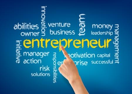 Hand pointing at a Entrepreneur word illustration on blue background. Foto de archivo