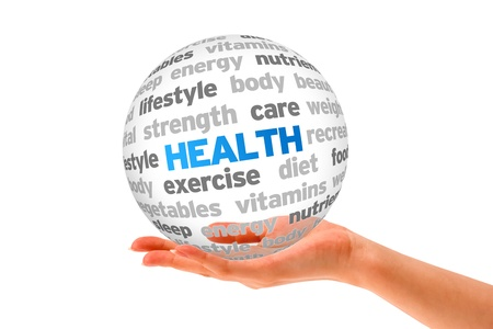 Hand holding a Health Word Sphere on white background.
