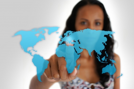 europe: Young latin woman pointing with a finger iof a world map.