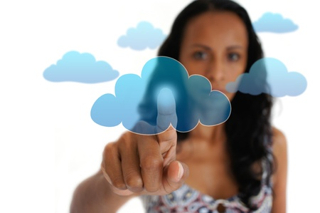 Young latin woman pointing with a finger at a cloud.