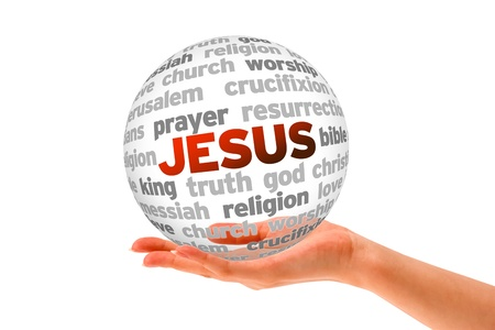 Hand holding a Jesus Word Sphere on white background.