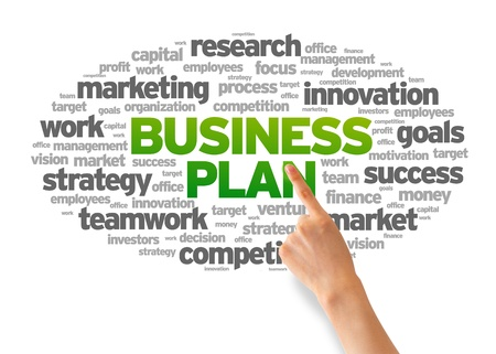 target business: Hand pointing at a Business Plan Word Cloud on white background. Stock Photo