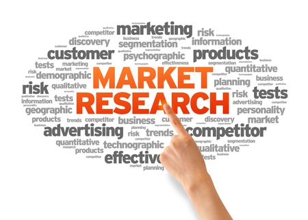 public market: Hand pointing at a Market Research Word Cloud on white background. Stock Photo