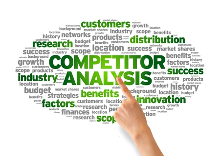 competitors: Hand pointing at a Competitor Analysis Word Cloud on white background.