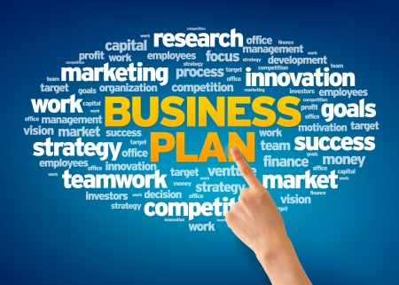 creative goal: Hand pointing at a Business Plan Word Cloud on blue background. Stock Photo