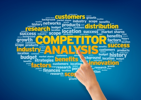 Hand pointing at a Competitor Analysis Word Cloud on blue background. photo