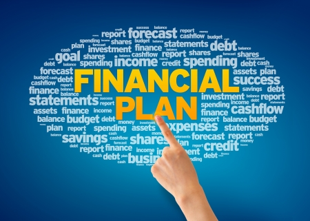 Hand pointing at a Financial Plan Word Cloud on blue background.
