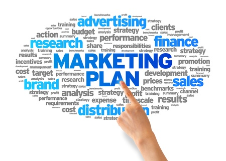marketing plan: Hand pointing at a Marketing Plan Word Cloud on white background.