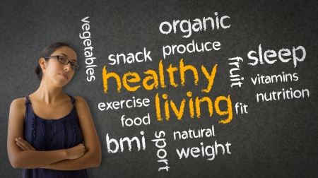 Woman standing next to a Healthy Living word illustration. illustration