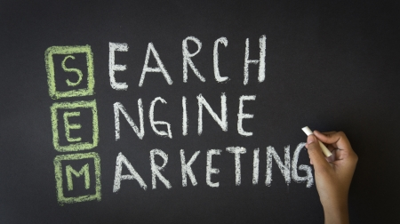 webmaster website: Person drawing a Search Engine Marketing Illustration with chalk on a blackboard. Stock Photo