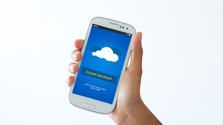 A person holding a Mobile phone with Cloud Account Login. photo