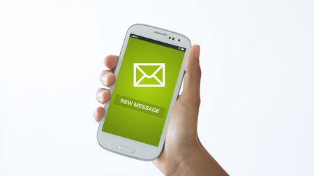 sms: A person holding a Mobile phone checking new messages.  Stock Photo