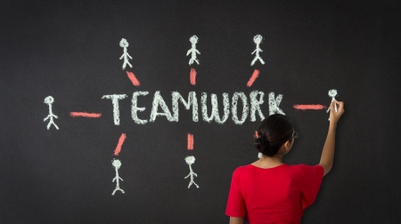 A person drawing a teamwork diagram with chalk on a blackboard Stock Photo - 18306905